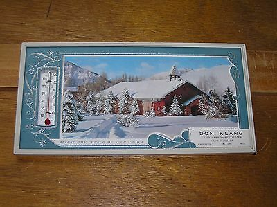Small Don Klang Grain Feed Farm Supplies Advertising with Snow Covered Mountain