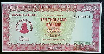 ZIMBABWE $10,000 Dollar, P22-B, 2003 **RARE ACTING GOVERNOR** Bearer Cheque aUNC