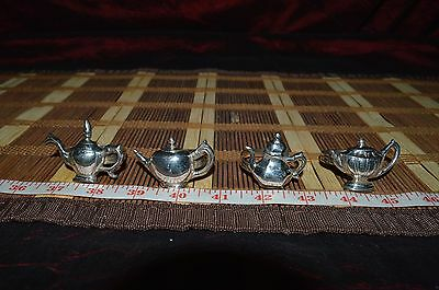 4 Silver-Plate Teapot Napkin Ring Holders