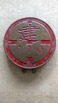 Asian military badge. Brass with red paint. Asian symbols and number 110