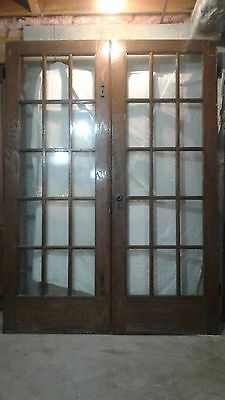 Antique set of Library Doors,15 panes of glass in each door.