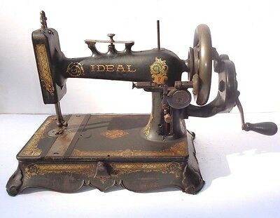 """ANTIQUE NEW HOME """"IDEAL"""" HAND-CRANK SEWING MACHINE w/CAST IRON BASE, SHUTTLE."""