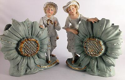 Two antique German bisque figurine vases boy and girl with gold gilt the boy is