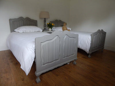 Pair of antique single beds with slats