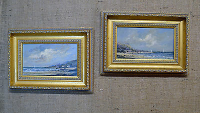 Pair of framed vintage oil paintings, sea scapes, in gilt frames, signed Russell