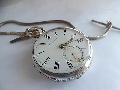 an antique hallmarked silver kendal and dent pocket watch with chain .