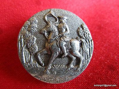 3720-D – French Soldier on Horse Playing French Horn White Metal Vintage Button