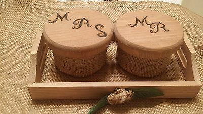 Mr. & Mrs. ring boxes with ring bearer tray all lined with burlap.