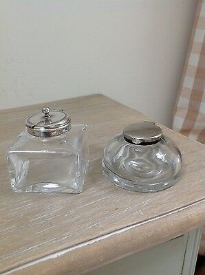 Two vintage glass inkwells with brass tops