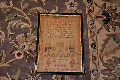 1814 Dated Sampler with houses, trees, flower baskets etc.