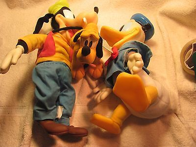 "3 Disney toys. Donald 12"", Goofy 16"" and Pluto stuff for kids 7"""