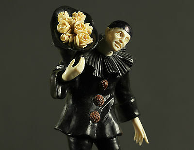 Pierrot with bouquet of flowers