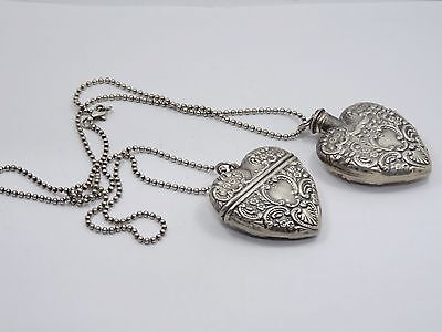 ANTIQUE PAIR of  STERLING REPOUSSE HEART PERFUME BOTTLE AND LOCKET