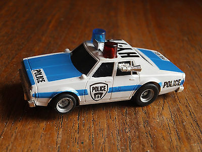 Aurora-AFX POLICE CAR w. RED+BLUE ROOF LIGHTS,magnatraction chassis Tyco HO car