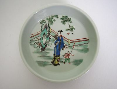 A Faille Verte 'Lady and kid' Dish, with Wooden Stand and Mark