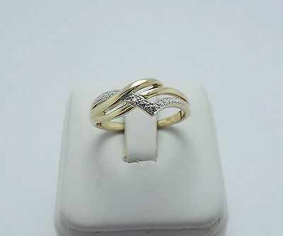 9ct YELLOW GOLD DIAMOND CROSS OVER RING - RING SIZE O