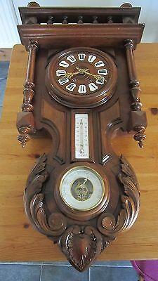 A Victorian  Ornate Triple Dial French Wall Clock
