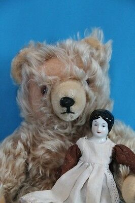 Old Teddy Bear mohair jointed , with china doll.  Mystery Bear.