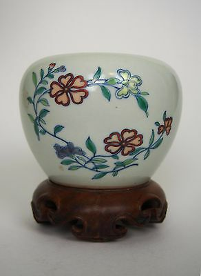 A 'Doucai' Floral Jar with Wooden Stand