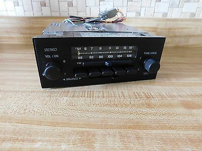 OEM 1982-88 Ford Lincoln Mercury AM FM Stereo Pushbutton Radio with Bracket