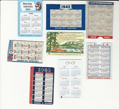 Vintage Chevron, Standard, and Union 76 Oil Pocket Calendars and holders