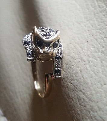 dog lovers 9ct gold ring with black sapphires and a diamond