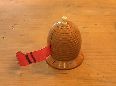 Antique turned wood treen sewing tape measure. Beehive