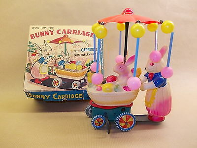 Wind-up tin/celluloid Bunny Carriage with Carrousel Made in Japan