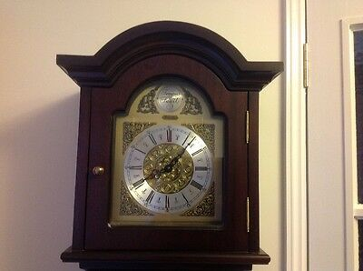 Thomas Byrne Reproduction chiming clock. Strikes every quarter,brass weights etc