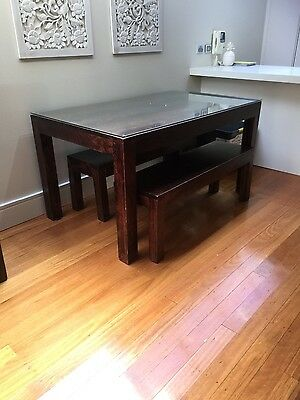 Solid Timber dining table with bench seats chairs and glass top