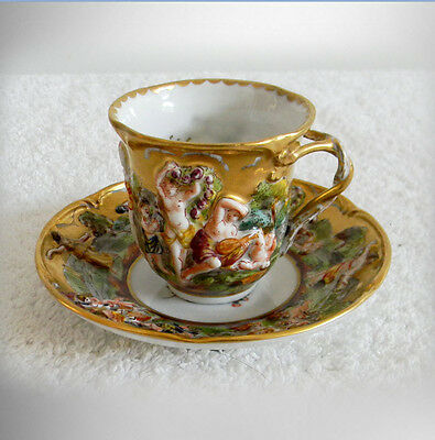 Capodimonte vintage cup and saucer with figures in high relief - FREE SHIPPING
