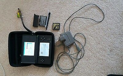nintendo ds lite console with charger case and extras