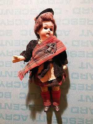 """Articulated 5"""" bisque Scottish girl doll, with thistle pin on sash"""