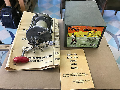 penn monofil grey 25 in box with catalog fishing reel