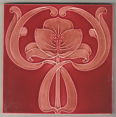 Tile With Majolica Molded Art Nouveau Design In Dusty Pink On A Plum Background