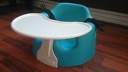 Bumbo Baby Seat with factory fitted safety straps and detachable play tray.
