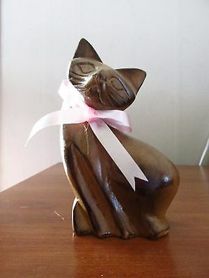 hand carved vintage wooden cat with pink ribbon
