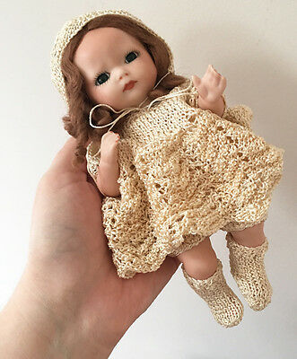 Hand painted porcelain baby doll - crochet clothes - tiny babe - reproduction