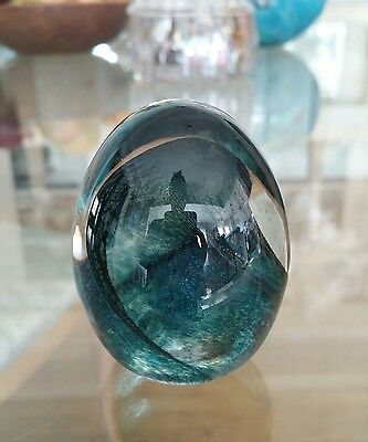 Iridescent glass egg paperweight green signed