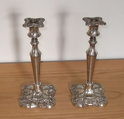 Pair of vintage white metal ornately decorated candle holders