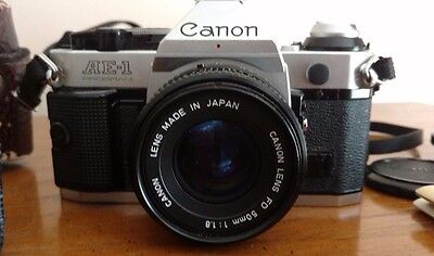 Canon AE-1 SLR 35mm Film Camera with 50mm 1:1.8 70-210mm Lenses Lots of extras