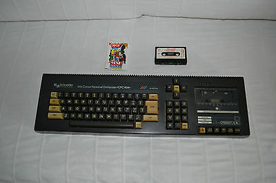 Schneider CPC464 with new tape belt fitted and two games