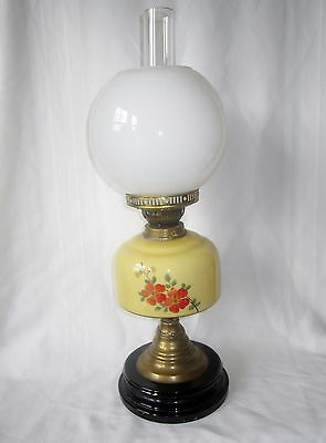 Antique large oil lamp with yellow glass reservoir, funnel & milk glass globe