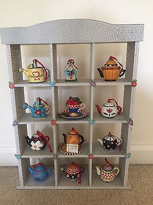 Mary Engelbreit Shelf with 8 teapots, 2 watering cans, 1 teacup and 1 birdhouse