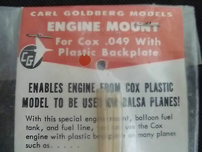 CARL GOLDBERG , RARE ENGINE MOUNT BACKPLATE, etc. NEW IN PACK SUIT COX .049.