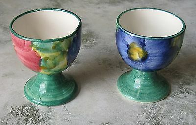 A Pair Of Attractive China Egg Cups With Large Floral Decoration