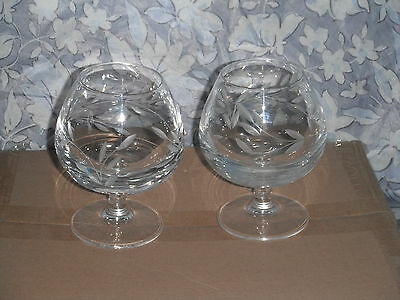 A pair of Caithness cut glass brandy glasses