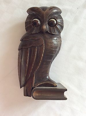Antique wooden owl clock with rotating eyes