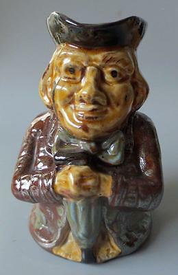 Antique Treacle Glaze  Pottery Toby Jug Decorated With Silver Lustre