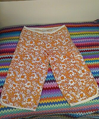 Unisex floral Rip Curl board shorts. Orange and white. Size 40. Good condition.